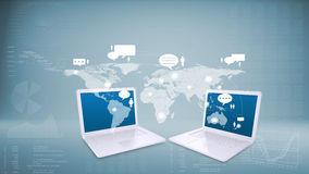 Two laptops with world map on screens Stock Photo