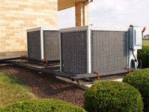 Two large air conditioners stock photography