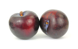 Two Large Black Plums Stock Photos