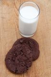 Two large chocolate chip cookies with milk Royalty Free Stock Image
