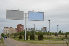 Large city billboards on the background of the city and the cloudy, gloomy Northern sky stock photos