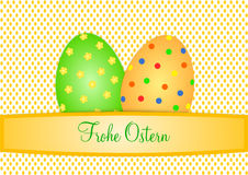 Two large colorful Easter eggs on small orange eggs with German lettering Royalty Free Stock Images