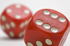 Two Large Dice. A pair of tumbling red dice stock images