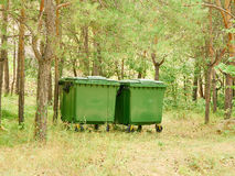 Two large green garbage container outdoors Royalty Free Stock Image