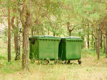 Two large green garbage container outdoors Stock Images