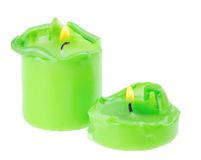 Two large green lighted candle Royalty Free Stock Image