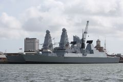 Two large grey warships moored in portsmouth harbour Royalty Free Stock Photo