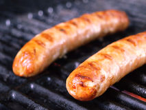 German Sausage cooking on the barbecue Stock Photo