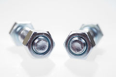 Two large metal bolt with nut tightened Royalty Free Stock Images