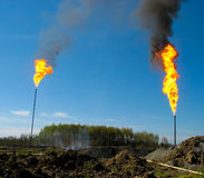 Two large oil flares Stock Photography