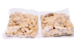 Two large plastic bags of peanuts Royalty Free Stock Photos