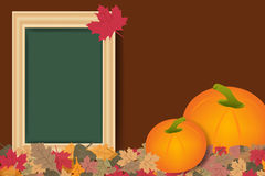 Pumpkins and empty chalkboard ready for your text Stock Photos