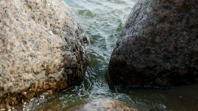 Between two large rocks like a wave. From the sea stock video footage