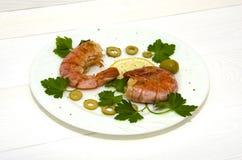 Two large shrimp on  round white plate Royalty Free Stock Photos