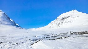 Two large snowy mountains royalty free stock photo