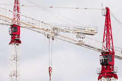 Two large steel construction cranes close together Royalty Free Stock Photo