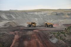 Free Two Large Yellow Coal Mining Loader Trucks Passing On A Road Stock Photography - 218473872