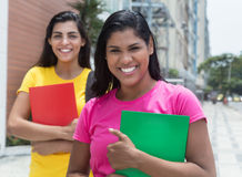 Two latin female students in the city Royalty Free Stock Photo