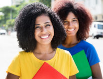 Two latin female students looking at camera Stock Image