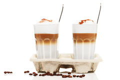 Two latte macchiato with chocolate powder in a cupholder Royalty Free Stock Photos