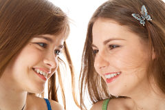 Two laugh teenage girls. Isolated on white background Stock Photo