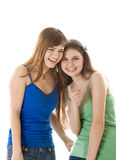 Two laugh teenage girls. Isolated on white background Royalty Free Stock Images