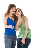 Two laugh teenage girls. Isolated on white background Stock Photos
