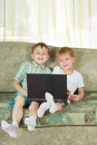 Two laughing boys with notebook Royalty Free Stock Photo