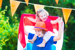 Two laughing funny kids Dutch football supporters Royalty Free Stock Images