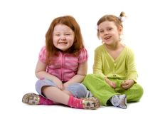 Two laughing girls. Two laughing little girls, isolated on white Royalty Free Stock Images