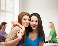 Two laughing girls hugging Stock Photos