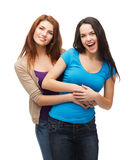 Two laughing girls hugging Stock Photography
