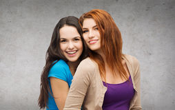 Two laughing girls hugging. Friendship and happy people concept - two laughing girls hugging Stock Photos