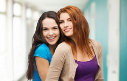 Two laughing girls hugging. Friendship and happy people concept - two laughing girls hugging Stock Image