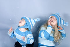 Two laughing girls in snow. Two cute girls laughing and playing in snow (studio Stock Photos