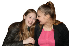 Two laughing girls on a white background. Isolate Stock Photography