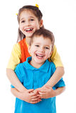Two laughing little children standing together Stock Image