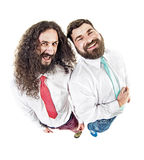 Two laughing ners posing in office Stock Photography