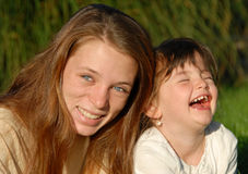 Two laughing sisters Stock Photo