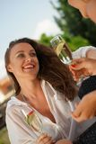 Two laughing women drinking sparkling wine Royalty Free Stock Image