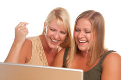 Two Laughing Woman Using Laptop Royalty Free Stock Photos