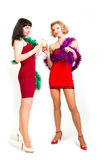 Two laughing women. At party celebrating with champagne Royalty Free Stock Image
