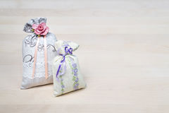 Two lavender scent sachets on wooden board or table. Scented pouches on wood with copy space. Fragrant bags for fresh home. royalty free stock image