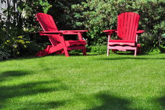 Two lawn chairs royalty free stock images