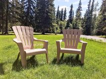 Two Lawn chairs on Grass Royalty Free Stock Photography