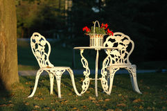 Two Lawn Chairs and a Table Outdoors Royalty Free Stock Image