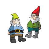 Two Lawn Gnomes. Two isolated lawn gnomes standing and smiling Stock Images
