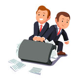 Two lawyers dragging huge briefcase full of papers Stock Photo