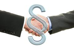 Two lawyers shaking hands - paragraph symbol royalty free stock image