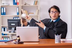 The two lawyers working in the office royalty free stock images